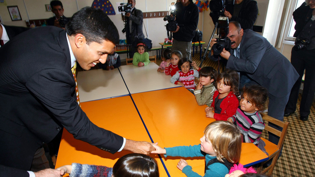 Rajiv Shah (left), the head of USAID, speaks with children during a visit at the Oncupinar Syrian refugee camp in Turkey, near the Syrian border, on Nov. 27. (AFP/Getty Images)