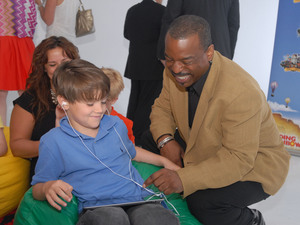 LeVar Burton and 7 year old Shane Ammon exploring the all Reading Rainbow adventure app at the