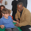 "LeVar Burton and 7 year old Shane Ammon exploring the all Reading Rainbow adventure app at the ""Reading Rainbow Relaunch"" event in June."