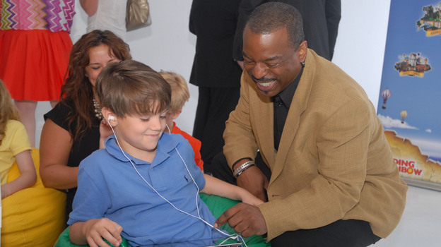 "LeVar Burton and 7 year old Shane Ammon exploring the all Reading Rainbow adventure app at the ""Reading Rainbow Relaunch"" event in June. (AP)"