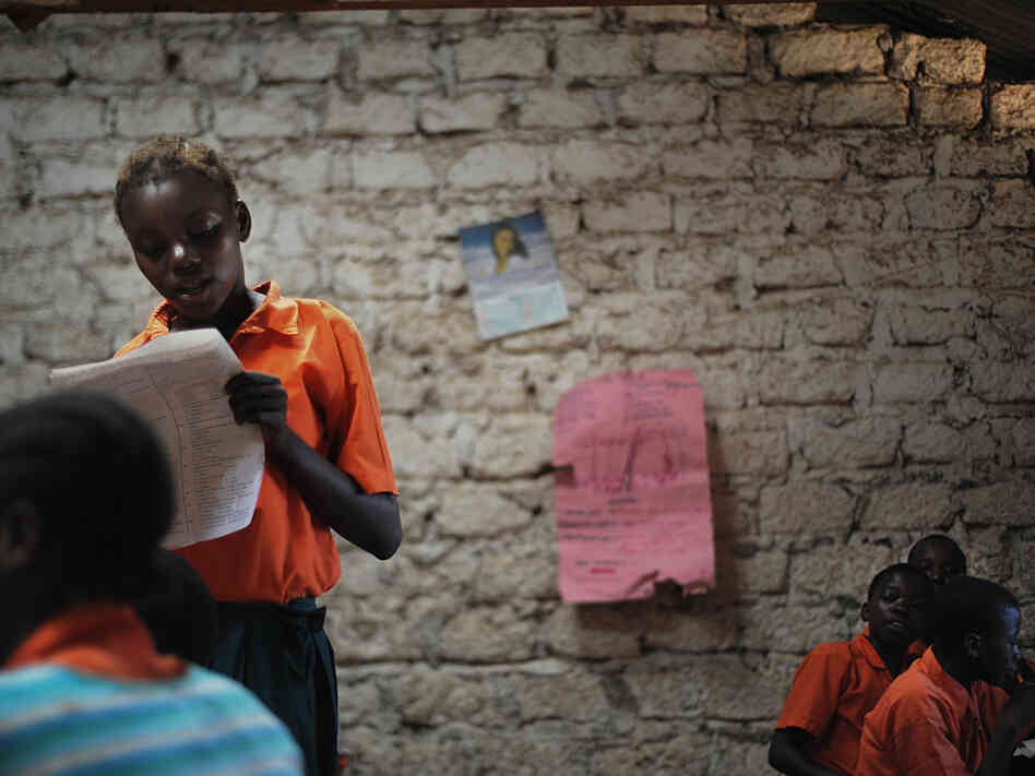 A schoolgirl participates in a lesson in Kilifi, about 30 miles northeast of Mombasa on Kenya's Swahili Coast, in 2010.