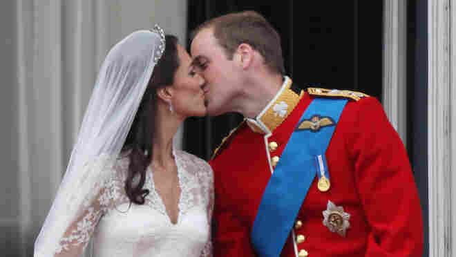 April 29, 2011: Their Royal Highnesses Prince William, Duke of Cambridge and Catherine, Duchess of Cambridge kiss on the balcony at Buckingham Palace after their wedding.