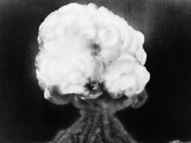 The mushroom cloud of the first atomic explosion at Trinity test site in the southern New Mexico desert on July 16, 1945.