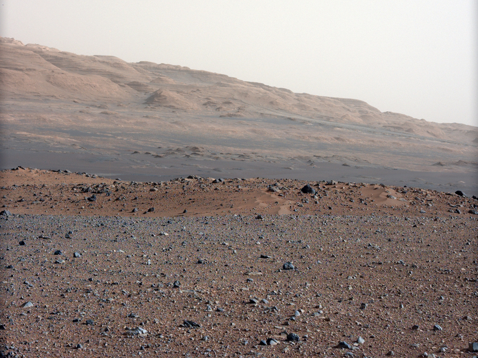 This photo, taken by NASA's Curiosity rover, shows Mars' Gale Crater, where the rover has taken samples for chemical analysis. Scientists believe that at some point in the very distant past, there was a riverbed here.