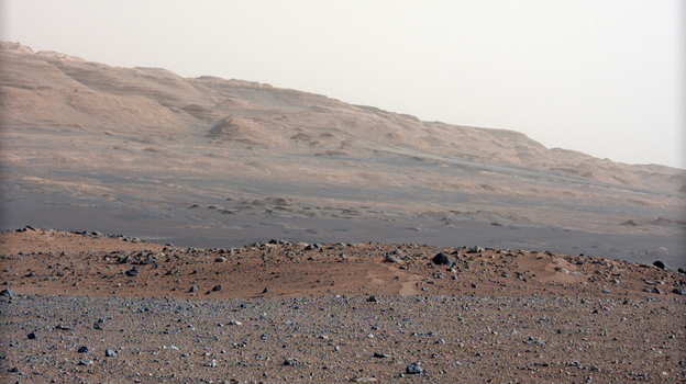 This photo, taken by NASA's Curiosity rover, shows Mars' Gale Crater, where the rover has taken samples for chemical analysis. Scientists believe that at some point in the very distant past, there was a riverbed here. (AP)