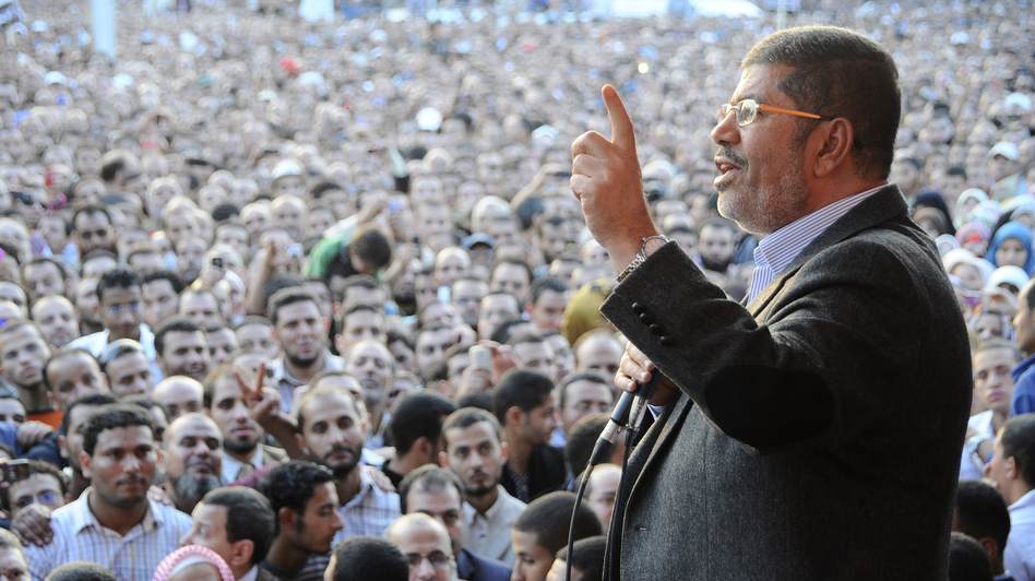 Egyptian President Mohammed Morsi speaks to supporters outside the presidential palace in Cairo on Nov. 23, a day after he issued decrees that gave him sweeping powers. (AP)