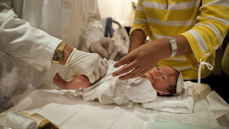 Rabbi A. Romi Cohn, a noted mohel, prepares an infant for circumcision at Congregation Shaare Zion in Brooklyn on Sept. 4. Cohn opposes a New York City rule requiring parental consent for a type of circumcision ritual practiced by some Orthodox Jews. (Redux)