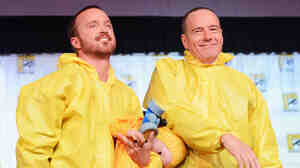 "SAN DIEGO, CA - JULY 13: Actors Aaron Paul and Bryan Cranston speak at AMC's ""Breaking Bad"" Panel during Comic-Con International 2012 at San Diego Convention Center on July 13, 2012 in San"