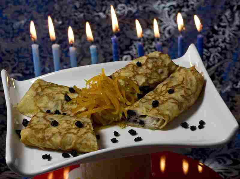 Lemon and dried blueberry blintzes, filled with creamy ricotta cheese, provide a tasty way to serve dairy and honor Judith for Hanukkah.