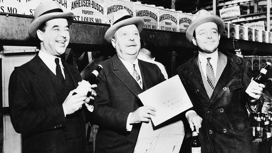 August A. Busch (center) and his sons, Adolphus III (left) and August Jr., seal the first case of beer off the Anheuser-Busch bottling plant line in St. Louis on April 7, 1933, when the sale of low-alcohol beers and wines was once again legal. Prohibition didn't officially end until Dec. 5 of that year. (AP)