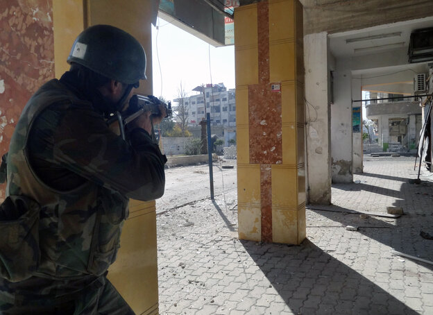 A Syrian soldier aims his rifle during clashes in the Damascus suburb of Daraya on Sunday. There is frequent fighting in and around Damascus, and residents are increasingly worried about a major battle for the capital.