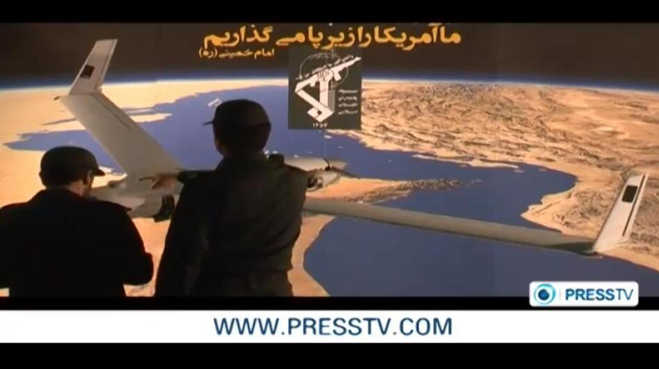 A screen image from the video released by Iranian TV of what the military there claims is a captured U.S. drone.