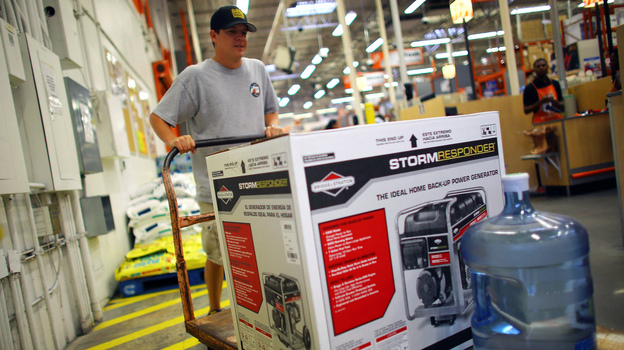 Home Depot has long offered credit cards, partly to serve customers who have just suffered major house damage. The company has recently widened those efforts. Here, a Tampa, Fla., customer buys a generator and bottled water, preparing for Tropical Storm Isaac's arrival in August. (Getty Images)