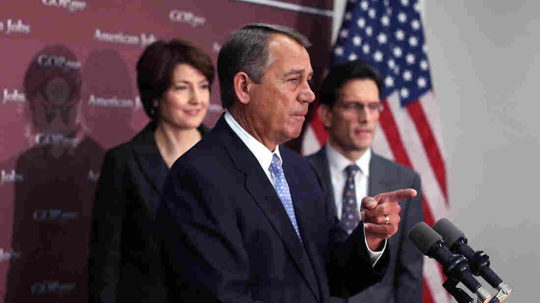 House Speaker John Boehner, R-Ohio, takes questions as House Majority Leader Eric Cantor, R-Va., and Rep. Cathy McMorris Rodgers, R-Wash., look on during a Capitol Hill news conference on Wednesday.