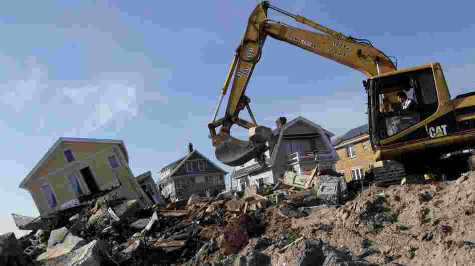 Cleanup continues on the site of a demolished home on the Rockaway Peninsula in New York on Nov. 29.