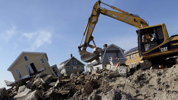Cleanup continues on the site of a demolished home on the Rockaway Peninsula in New York on Nov. 29. (AP)