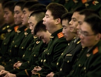Must ... stay .... awake: A Chinese paramilitary police officer yawns and his colleagues fall asleep while then-President Hu Jintao delivers a speech at the Great Hall of the People in Beijing, China, Dec. 18, 2008.