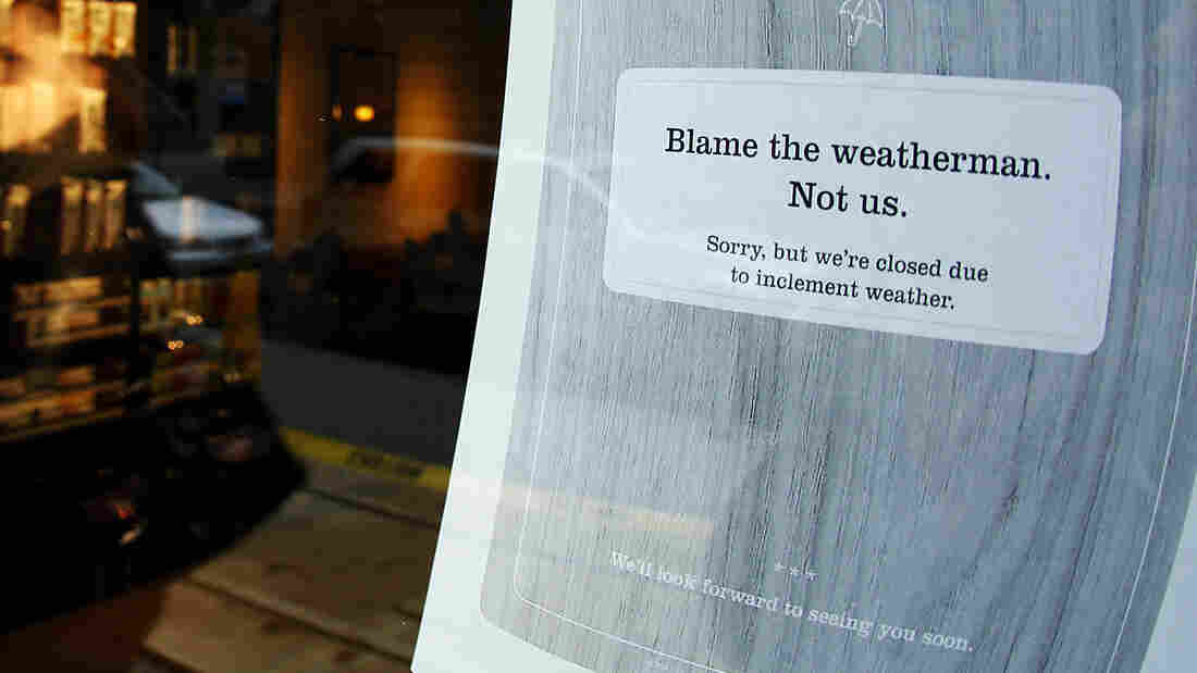 """A """"closed"""" sign at a coffee shop in New York City, where many businesses had to shut down for at least a few days before, during and after Superstorm Sandy."""