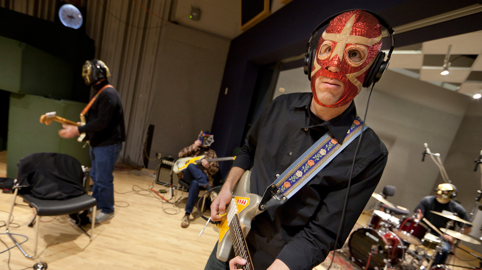 Los Straitjackets' members rehearse in NPR's Studio 4A. (NPR)