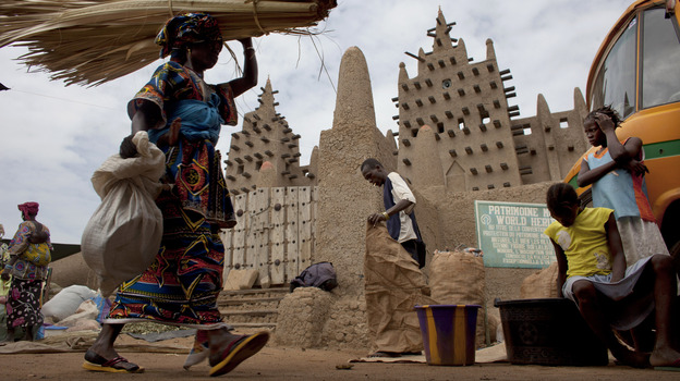 A woman walks by the Grand Mosque of Djenne on market day in Djenne, Mali, on Sept. 2. The UNESCO World Heritage-listed town is among the Malian tourist sites suffering from a huge drop in visitors after a coup took place in March and Islamist rebels seized control of the country's north. (Reuters/Landov)