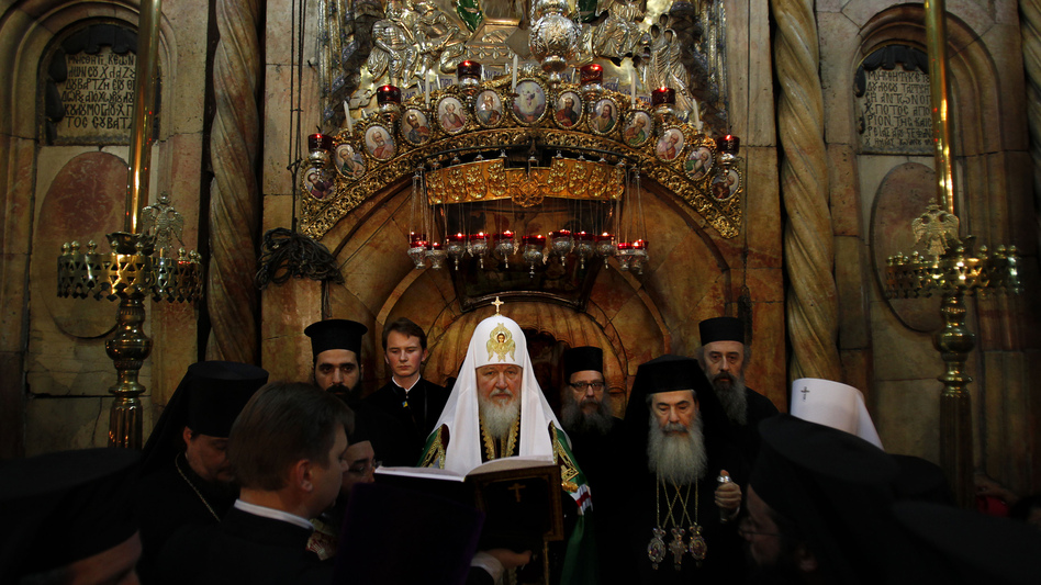 Greek Orthodox Patriarch of Jerusalem Theophilos III (right) and Russian Orthodox Patriarch Kirill (center) pray in front of the tomb of Jesus in the Church of the Holy Sepulcher in November. (AFP/Getty Images)