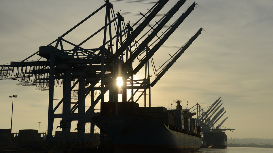Work can start again: This ship, loaded with containers, was sitting beneath idle cranes Tuesday at the Port of Los Angeles. (AFP/Getty Images)