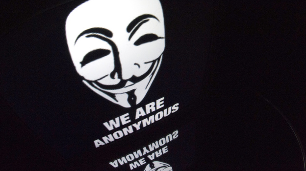 "The ""Anonymous"" logo is seen on a tablet screen. (AFP/Getty Images)"