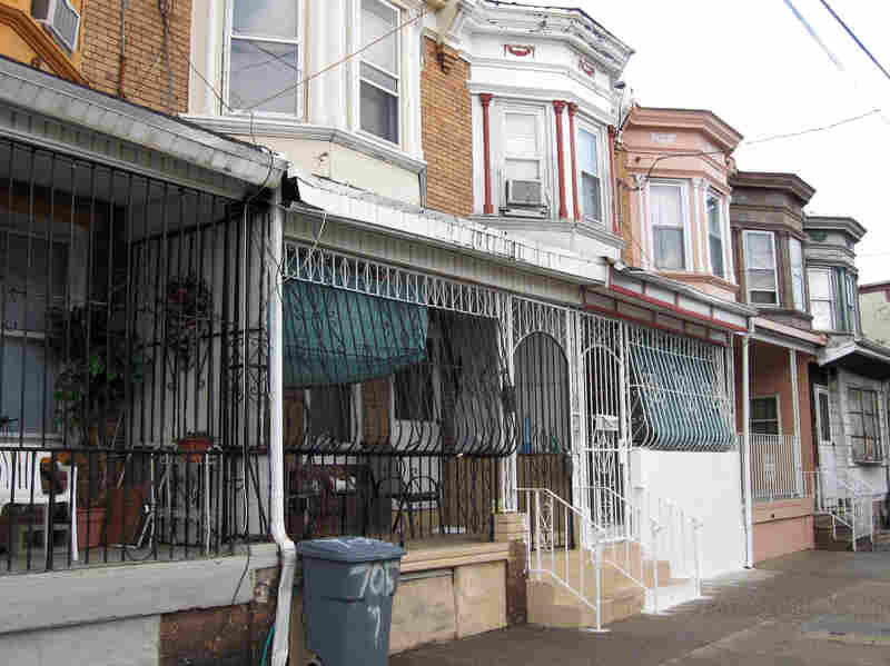 """Because of the city's high crime rate, protective iron bars encase the front porches of many houses in Camden. Residents call them """"bird cages."""""""