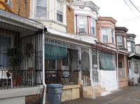 Because of the city's high crime rate, protective iron bars encase the front porches of many houses in Camden. Residents call them
