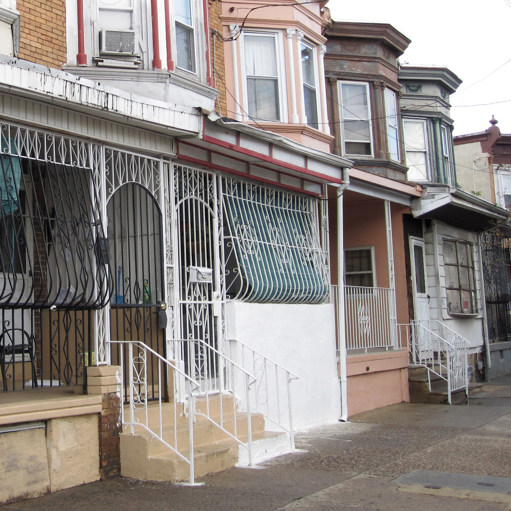 "Because of the city's high crime rate, protective iron bars encase the front porches of many houses in Camden. Residents call them ""bird cages."""