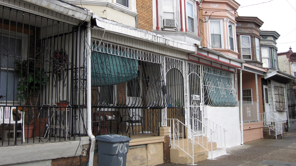 "Because of the city's high crime rate, protective iron bars encase the front porches of many houses in Camden. Residents call them ""bird cages."" (NPR)"