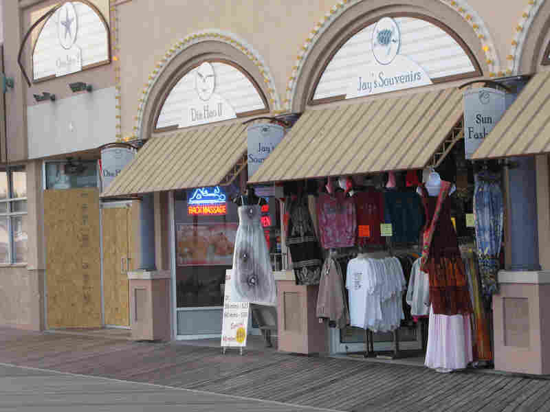 At Jay's Souvenirs on the boardwalk, Yaqob Abro says it costs him more to commute to work and keep the lights on than he's making in sales most days.