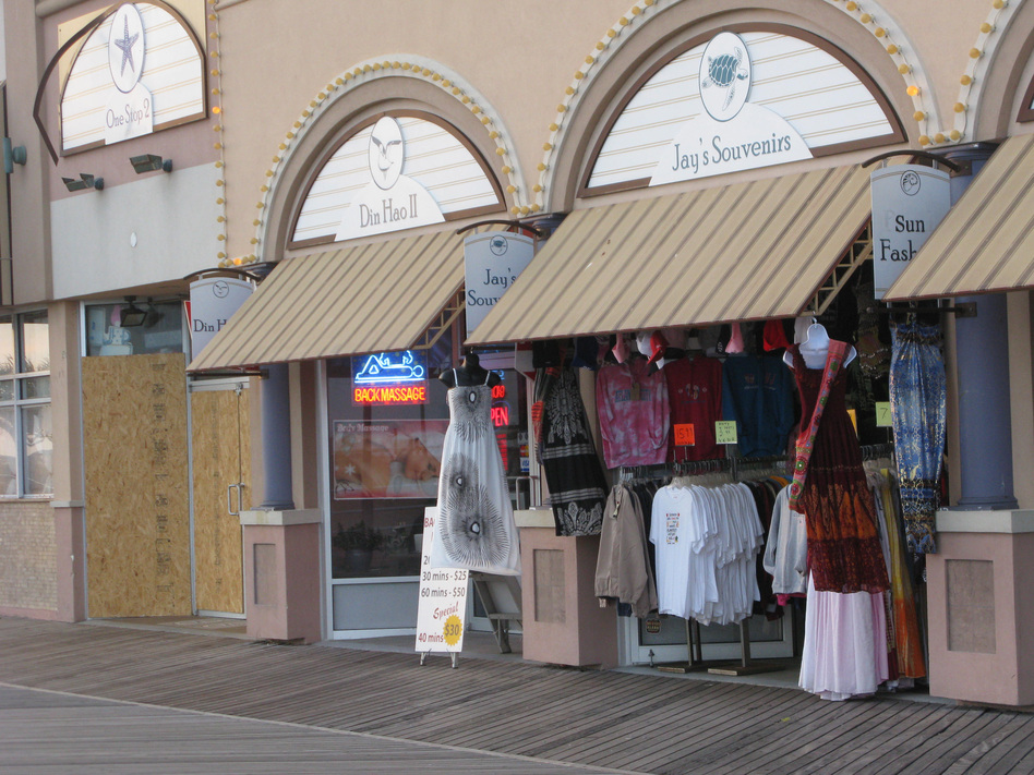 At Jay's Souvenirs on the boardwalk, Yaqob Abro says it costs him more to commute to work and keep the lights on than he's making in sales most days. (David Schaper/NPR)