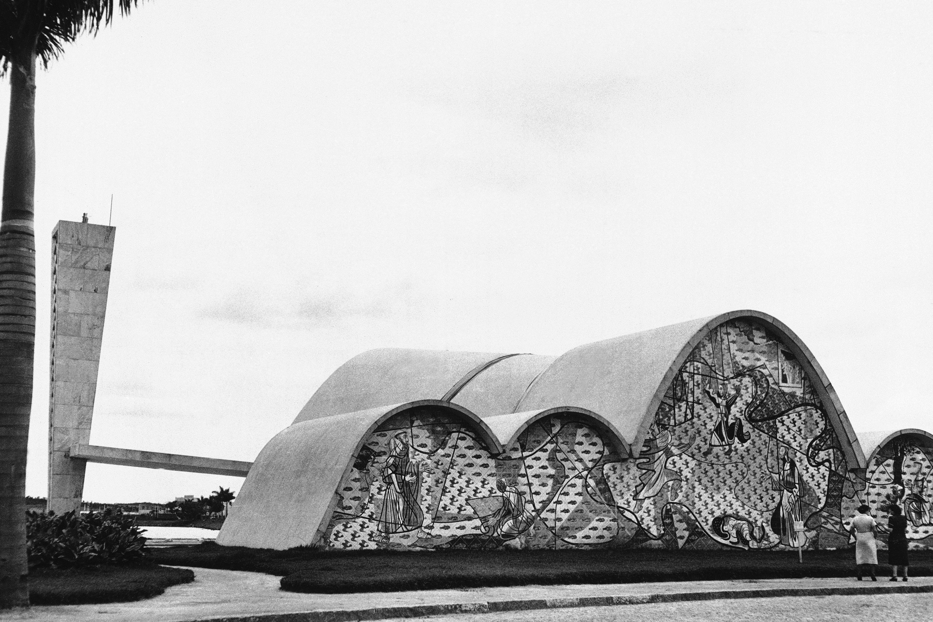 """One of Oscar Niemeyer's earliest projects, built in the early 1940s, came to be known as the """"Pampulha architectural complex."""" It was commissioned by Juscelino Kubitschek, who would later become president of Brazil. At the time, he was mayor of Belo Horizonte. The complex included a church, which was initially refused for consecration by the Roman Catholic Church."""