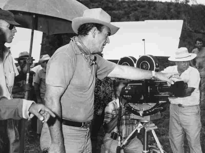 6-foot-4 actor John Wayne directs a scene for the Hollywood movie The Alamo in 1959. Wayne also portrays the reportedly 6-foot-tall Davy Crockett in the movie.