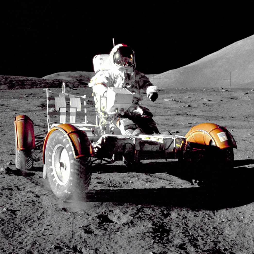 Cernan tests the lunar vehicle. He and Schmitt landed in the moon's Taurus-Littrow region. Evans stayed behind, orbiting the moon.
