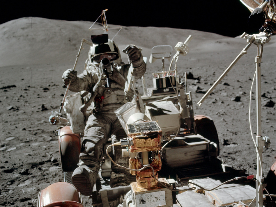 Cernan photographed Schmitt while he set up a transmitter used in a geological experiment. (NASA)