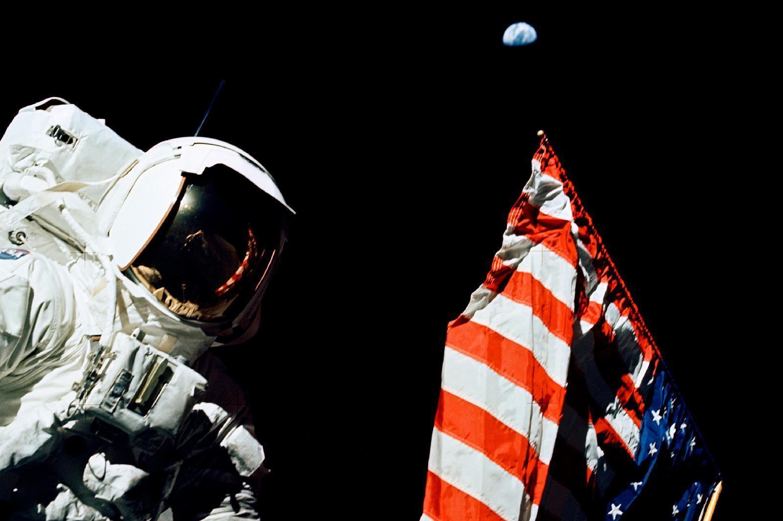 Schmitt stands by the American flag during a moonwalk. Look above the flag -- that's Earth, a quarter-million miles away.