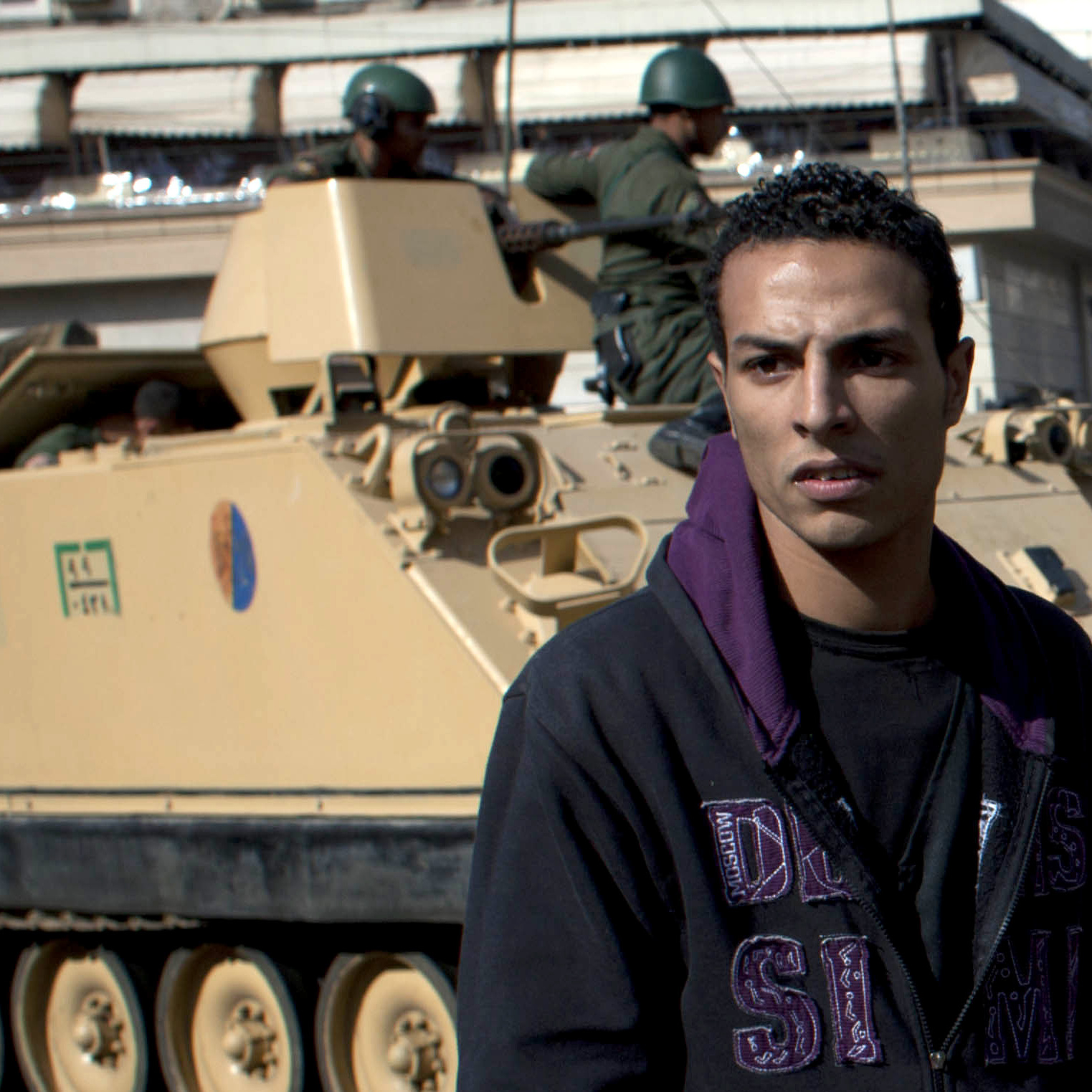 Egyptian army tanks deploy near the presidential palace after overnight clashes between supporters and opponents of President Mohammed Morsi in Cairo on Thursday.