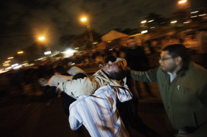 A man who had been with supporters of the Muslim Brotherhood when he was injured is carried from the scene.