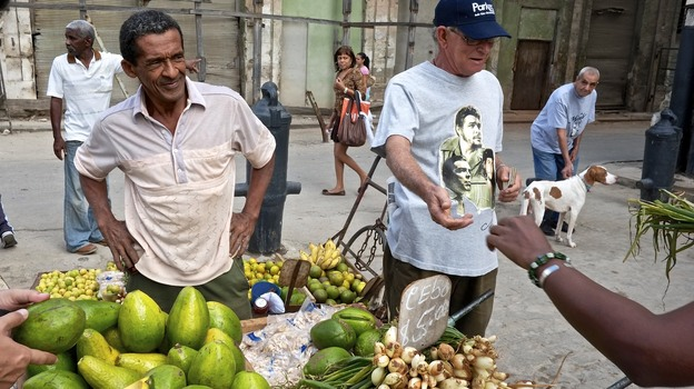 Cuba has relaxed some business rules, allowing street vendors to sell produce and a large wholesale produce market to open at night on the edge of Havana. (Getty Images)