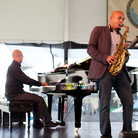 Saxophonist Miguel Zenón performs with pianist Laurent Coq at the 2012 Newport Jazz Festival.