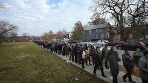 Looking for work: There was a long line last month as job seekers waited to get into an employment fair at Kennedy-King College in Chicago.