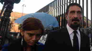 John McAfee, with a woman described as his girlfriend, on the way into the Supreme Court in Guatemala City on Tuesday.