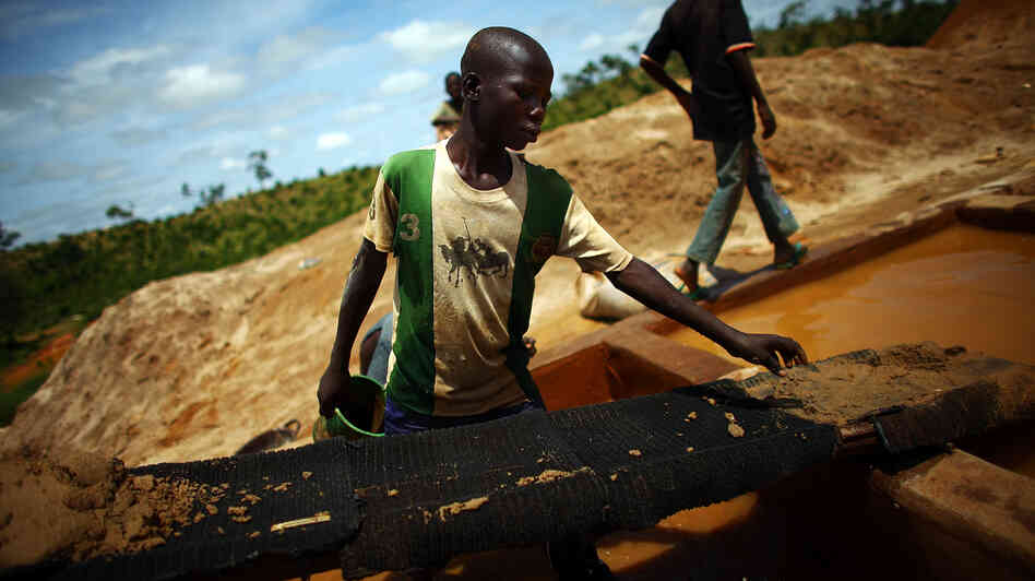 A boy works at an illegal gold mine in northern Nigeria. Lead from these