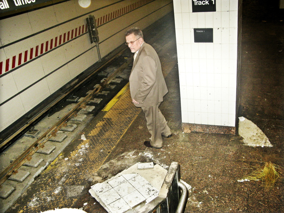 Joseph Leader, chief maintenance officer of the New York City subway system, surveys damage caused by Superstorm Sandy, this week at the South Ferry station.