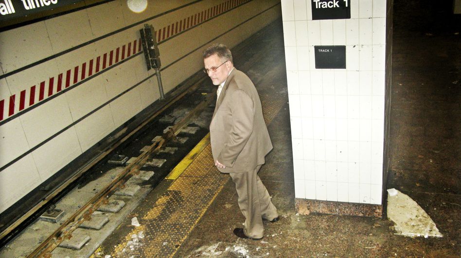 Joseph Leader, chief maintenance officer of the New York City subway system, surveys damage caused by Superstorm Sandy, this week at the South Ferry station. (NPR)