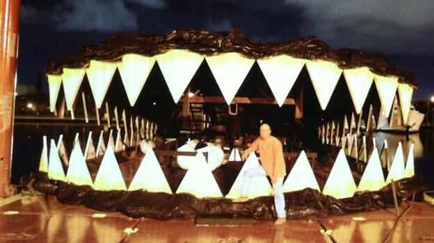 My what big teeth: Artist Lloyd Goradesky with his alligator.