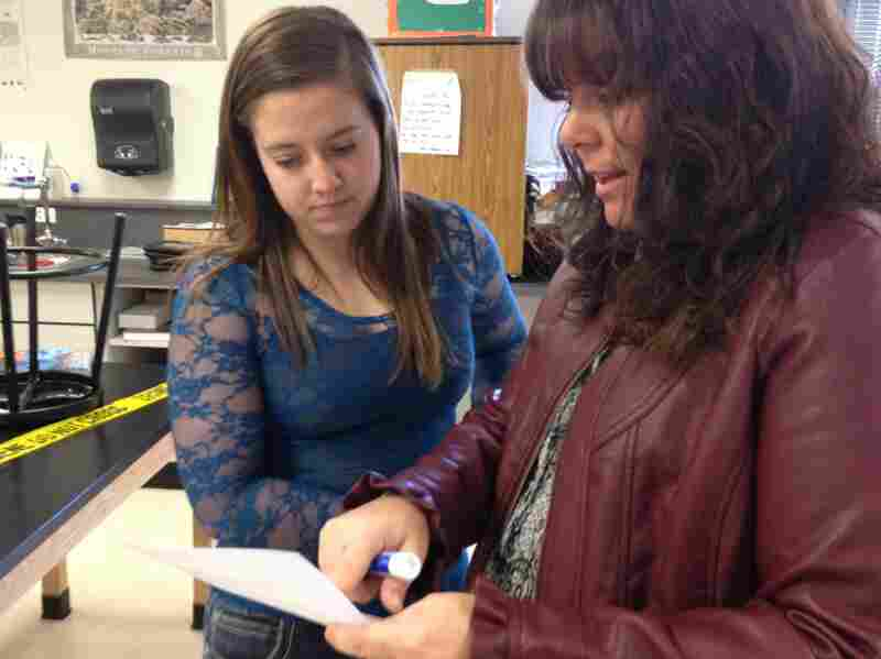 """Jessica goes over her work with teacher Jennifer Goodnight. Goodnight says """"flipping"""" her class has improved students' test scores."""