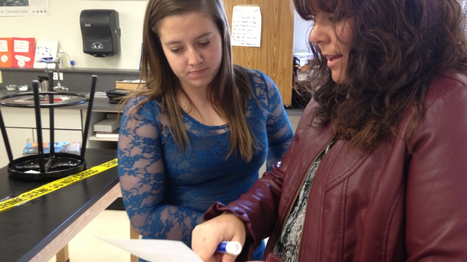 "Jessica goes over her work with teacher Jennifer Goodnight. Goodnight says ""flipping"" her class has improved students' test scores."